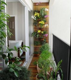 This is a pure balcony garden with no seating space, and you can grow herbs, flowers, crotons and other small plants in your balcony. You can also make use of ladders, shutter doors, or wooden stripes on the walls to add extra plants to the balcony space.