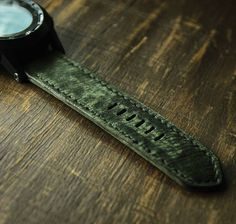 26mm army green distressed soft leather strap with black stitching.
