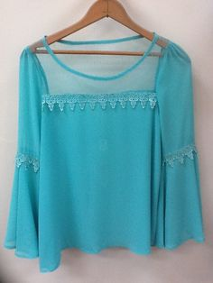 Bright MINT top with great lace accents and flutter sleeves $35