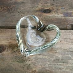 Check out this item in my Etsy shop https://www.etsy.com/ca/listing/470988616/heart-shaped-art-glass-ashtray-candy