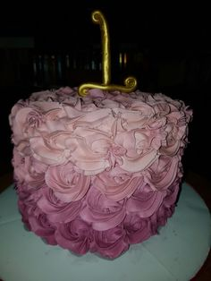 Ombre rosette cake with ombre cake inside this was my neice's smash caje