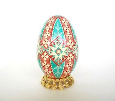 Check out this item in my Etsy shop https://www.etsy.com/ca/listing/51622930/christmas-pysanka-turquoise-and-red