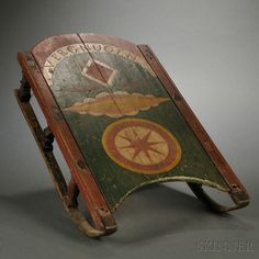 Paint-decorated Child's Sled, America, likely made by a German immigrant, late 19th century, with incised and painted wooden seat panel depicting incised outlined diamonds and compass star shapes,