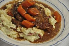 Coca Cola Roast - ! beef roast, 1 can cream of mushroom soup, 1 pkg onion soup mix, 12 oz can coke, potatoes and carrots
