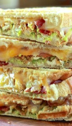 Chicken, Bacon and Avocado Panini - 4 chicken tenders, 6 slices of bacon, 4 slices bread, 2 slices cheese, 1 tbsp. ranch, 1/2 avocado mashed with lime juice and salt... yum!