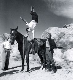"An unknown stuntman shows off for Kirk Douglas during the filming of ""Along the Great Divide"" ('51) in Lone Pine, CA."