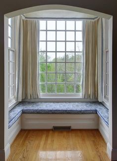 Cozy U-shaped custom window seat - Private reading space with high windows.