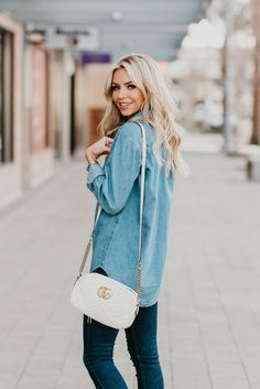 Listing SEVERAL ways to style a chambray shirt! Chambray shirts are a closet staple and are very versatile! You can wear with skirts, white denim, black denim, leggings, buttoned-up or open and more! It is perfect for Spring but can also span multiple seasons! A win win for your fashion style! #womensfashion #chambrayshirt