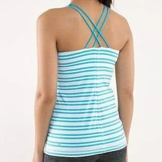 "Lululemon ""free to be tank"" Lululemon free to be tank in turquoise and white stripes.  Light support and a strappy open back. Lightweight luxtreme fabric.  Criss-cross back straps make it easy to move.  Designed with built in pockets for removable cups.   This tank is new.  I tried it on and removed tags.  I still have original tag (pic 3). Comes with reusable LULULEMON bag.  This tank is SOLD OUT in stores. lululemon athletica Tops Tank Tops"