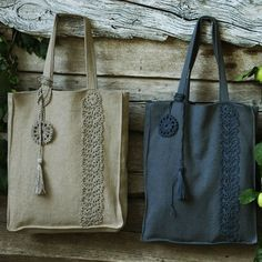 A beige and a dark grey lace decorated handbag hanging on a wooden trunk. A beige and a dark grey lace decorated handbag hanging on a wooden trunk. Hippie Bags, Boho Bags, Wooden Trunks, Diy Handbag, Linen Bag, Fabric Bags, Womens Purses, Shopper, Cotton Bag