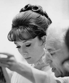 Audrey Hepburn photographed with director George Cukor on the set of My Fair Lady, 1963.