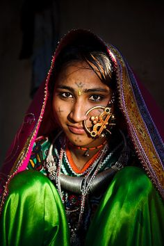 Portrait of a woman from the Marwada Meghwal Harijan tribe wearing traditional clothing and a large golden wedding ring through her nose in the village of Sumrasar, located roughly 30km from Bhuj in the Kutch District