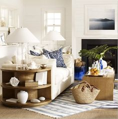 I love the end table...too bad that it would be prime place for my daughter to play! She would unload it every 5 seconds.