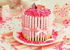 Love this Valentine's Day Cake-Pink and white chocolate covered pretzel surround a chocolate cake--See 10 different Valentines Cakes