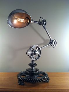 (via Industrial Desk Lamp Machine Gear Task Light Steampunk Rat Rod Vintage Parts | eBay)