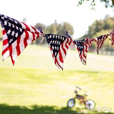 Fabulous flag bandana garland idea & lots more 4th of July party inspiration.