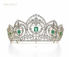 A magnificent diamond and emerald tiara, 1910, formerly belingto a Noble European Family. Featuring seven glarland foliate pannels, each with multiple scrolls, folwer head motifs and laurel leaf swags, under each diamond arch. To be auctioned at Sotheby's on 17 May 2016