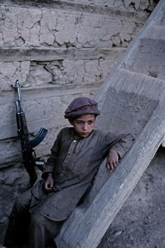 Child soldier in Nuristan, Afghanistan photo by: Steve McCurry We Are The World, People Of The World, Steve Mccurry Photos, James Nachtwey, World Press Photo, By Any Means Necessary, Robert Doisneau, Ansel Adams, Central Asia