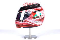 This is a very unique design requested by one of our clients, traditional Saudi head dress on a Arai GP-6 helmet.