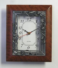 """5×7 Quartz Clock - Brown Mahogany - Roses on Trellis by Glory Land. $21.25. Hand Painted Two-Tone Wooden-Look Finish. Battery Operated Quartz Movement (Single """"AA"""" Battery Not Included). Cast Metal Center Trim. 5""""×7"""" Clock Face. Easel Stand. Glory Land Corporation has been supplying photo frames and gifts to customers around the world for over 29 years."""