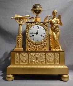 French Empire antique ormolu mantel clock of Astronomy signed Cartier.