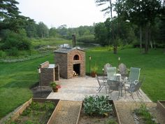 Some wonderful nights could be had with a wood fired pizza oven and patio like this.