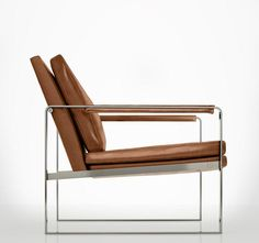Mid-century meets modern luxe. The Charles leather armchair exhibits a sleek silouette, featuring premium bicast leather upholstery. Padded leather arms adorn the angled flatbar stainless steel frame