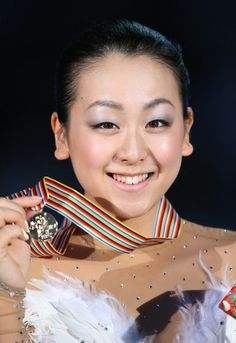 OSAKA, JAPAN - FEBRUARY 10:  Mao Asada of Japan pose after the medals ceremony during day three of the ISU Four Continents Figure Skating Championships at Osaka Municipal Central Gymnasium on February 10, 2013 in Osaka, Japan.