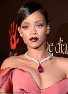 She's got sparkle: Rihanna dressed up her ensemble with a dazzling diamond and red stone pendant necklace