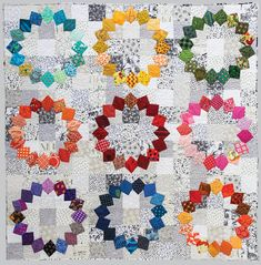"""Quilting Ideas Rainbow Quilts for Scrap Lovers - Learn to rescue and reuse fabric leftovers with 12 colorful quilt patterns for scrap lovers. Judy Gauthier teaches you her indispensible system for cutting usable squares from """"real,"""" oddly shaped scraps. Dresden Quilt, Circle Quilts, Quilt Blocks, Star Blocks, Quilting Projects, Quilting Designs, Quilting Ideas, Reuse Fabric, Nancy Zieman"""