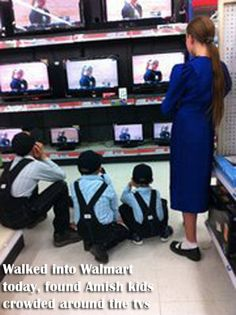 Amish kids watching tv at Walmart