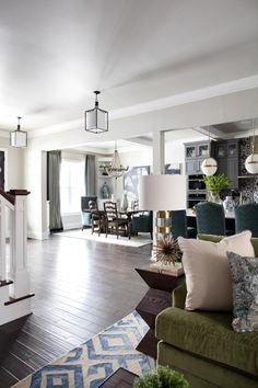 Intriguing textures, a wall of glass doors and chic furnishings are show stopping features in the living room and entertaining hub.