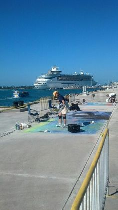 Chalk artists on the Truman Waterfront in Key West.