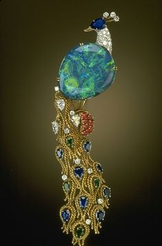 Brooch | Harry Winston. 32 ct black opal from Lightning Ridge (Australia), accented with sapphires, rubies, emeralds, and diamonds set in