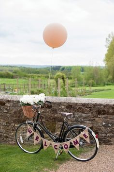 rustic bike weding welcome sign / http://www.himisspuff.com/bicycle-wedding-ideas/7/