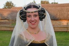 Crispinette (or caul).   A hair net to confine the hair that was plaited and coiled into ramshorns over the ears.    Ribbon can be added.  False ones are held on with a head band for young lady/maid and veil attached.