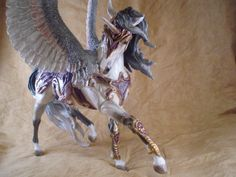 A commission I just finished. He was a breyer Esprit. Not much was done, I made his armor out of apoxie, painted in pastels and I use Kathleen moody wings, simple as pie See more photos on my faceb...