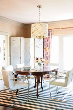 """""""Very wipeable and they don't tip over"""" is how Warner describes her Mies van der Rohe Brno chairs. We love the decorative chinoiserie screen against the modern striped rug! Lonny September 2014"""