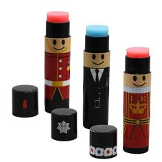 London Lip Balm Set. Featuring designs of a guardsman, a beefeater and a policeman, apply these strawberry and blueberry lip balms to dry areas to moisturise, nourish and condition.