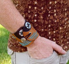 Handcrafted bracelet using repurposed leather, washers, and eyelets