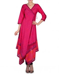 Raspberry pink angarkha style asymmetric tunic with floral prints all over. V neckline with side tie up detailing. Three quarter sleeves. Wash Care: Dry clean onlyPant worn by the model is only for styling purpose