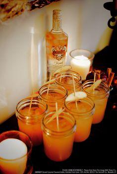 Smirnoff Caramel Apple Cider. Recipe: 2 oz Smirnoff Kissed Caramel flavored vodka, 5 oz apple cider. Fill shaker with ice and ingredients, shake, strain into mason jars and garnish with apple slices and cinnamon sticks. #Smirnoff #vodka #fall #apple #cider #drinkrecipe