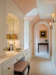 A bright, feminine dressing room.  Plenty of storage, mirrors and light.