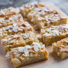 Frangipane butter, softened golden caster sugar 3 eggs 2 tbsp milk 1 tsp vanilla extract ground almonds self-raising flour For the topping pear, peeled and chopped 1 tbsp golden caster sugar flaked almonds Runny honey Icing sugar for dusting Almond Recipes, Baking Recipes, Cake Recipes, Dessert Recipes, Tray Bake Recipes, Food Cakes, Dessert Bars, Desserts Français, British Baking