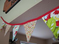 DIY banner flags.  Thrift store sheets!  Pick a color scheme, then non-match the hell out of the patterns.  Maybe leave edges frayed instead of sewn nicely.