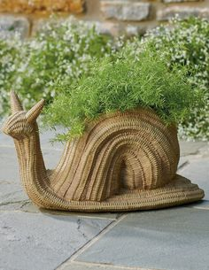 With the look of a vintage, woven wicker basket, Simon the Snail is crafted entirely from resin, so he's durable enough to prop your favorite plants, indoors or out. A clever find for your home, a nice gift idea, too. Garden Oasis, Real Plants, Flower Boxes, Snail, Wicker, Resin, Best Gifts, Clever, Planters