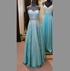Lovely prom dresses inspired by Elsa's blue gown in Disney's Frozen http://www.davonnajuroe.com/frozen-prom-dresses/