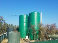 Coating storage tanks in California.