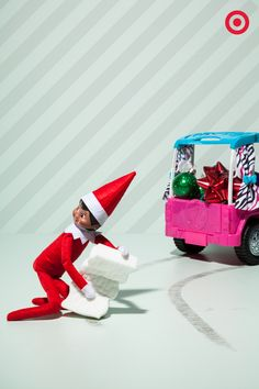 Looks like we caught Elf On The Shelf getting into some gift-hijacking hijinks. He lost control of his toy truck stacked with ornaments and bows. And now he's trying to use the magic eraser to cover his tracks. Here's hoping his hallway collision insurance is up to date!