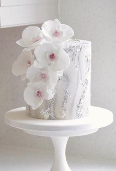Marble, silver leaf and sugar orchids cake for Silke. Over tall chocolate & salted caramel cake Floral Wedding Cakes, White Wedding Cakes, Floral Cake, Beautiful Wedding Cakes, Gorgeous Cakes, Orchid Wedding Cake, Orchid Cake, Salted Caramel Cake, Black And White Wedding Cake